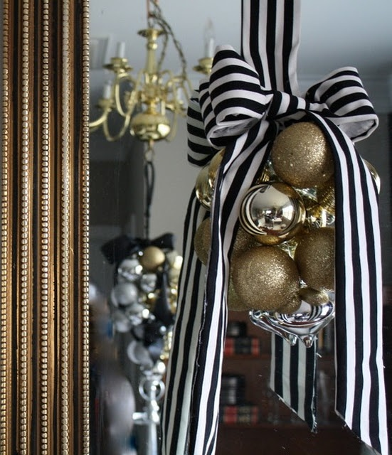 Bold striped black and white gros-grain ribbon and clustered gold tone ornaments (a few silver for accent)