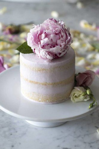 Peony Vanilla Cake Topper - Simple wedding cake made with vanilla cake and a delicate pink buttercream frosting.  This cake is very easy to make. #weddingcakes #desserts #bestcakes #cakes #peony