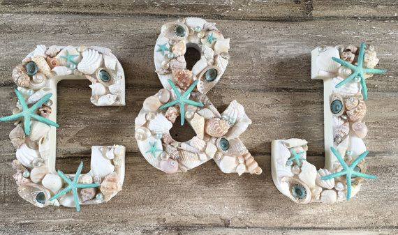Theres nothing that says beach wedding decor like this set of 3 custom colored seashell letters! Decorative letters can be used as wall initials, with other seashell decor, for cake topper initials or just laid flat on your sweetheart table. Personalized beach wedding decor can be coordinated and beautiful with these custom colored letters!  THIS LISTING INCLUDES -Set of 3 seashell letters (2 letters plus the & symbol) -Custom colored starfish on each letter (turquoise is shown in photos)…