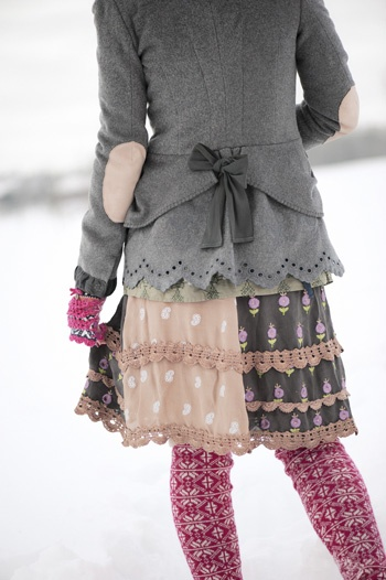 I like how the different fabrics in the skirt are tied together with trim.