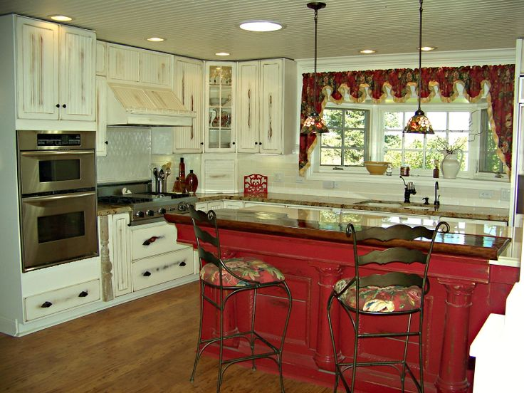 Red distressed island, white distressed cabinets ...