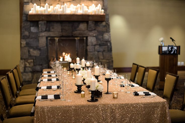Head table flowers and candles at @silvertipwed   Florals: www.flowersbyjanie.com  Photo: http://www.blakeloates.com