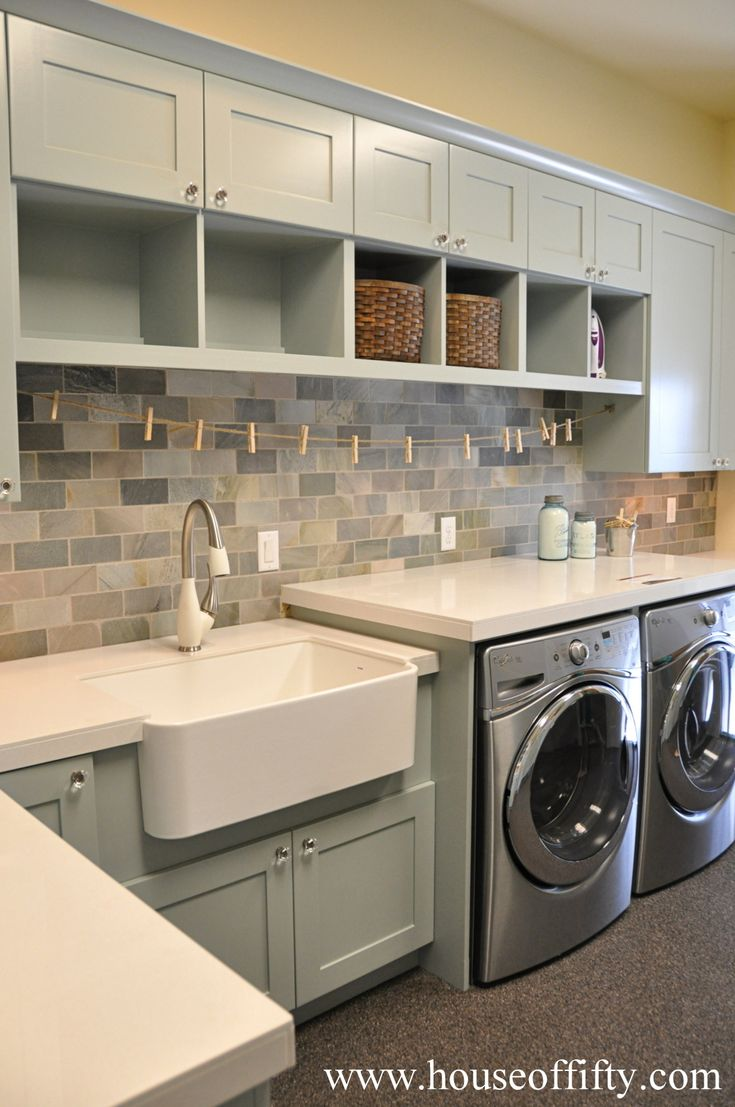 laundry room - upper cabinets + shelves with baskets, counter over washer/dryer