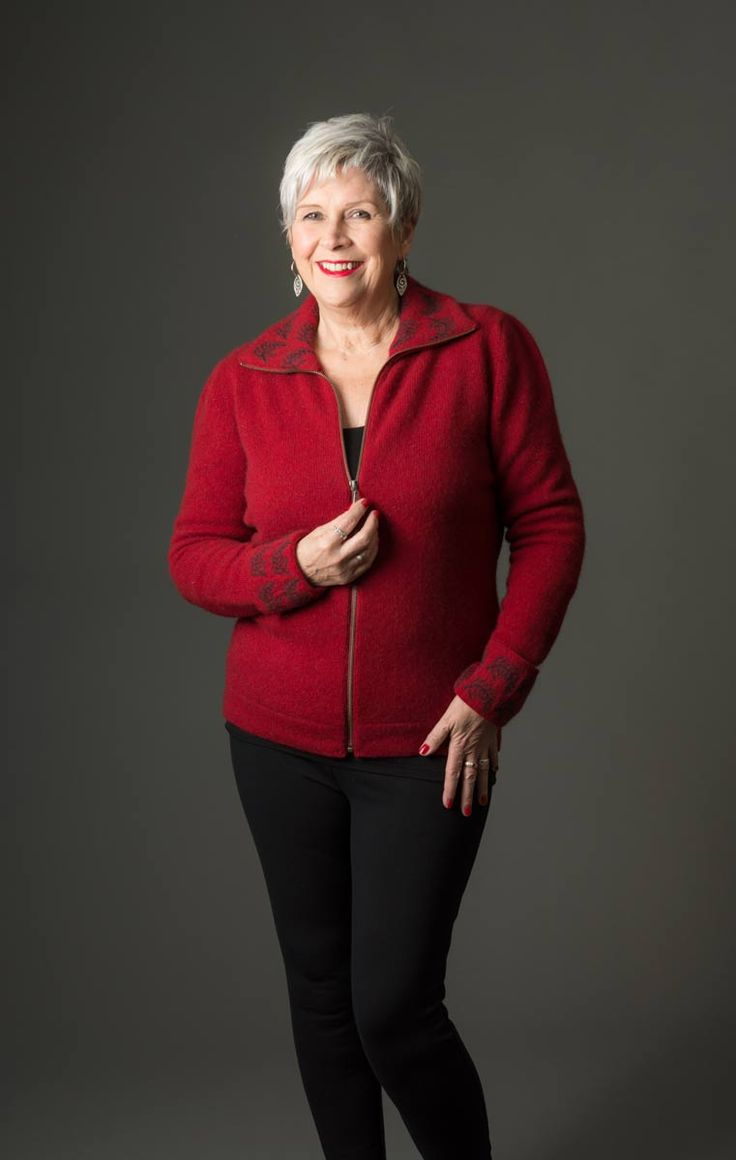 This red women's possum merino jacket has a front zip and a fern design on the collar and cuffs. It is easy wearing for the weekend or smart casual for during the day at work. Dress this jacket up with jewellery.