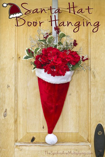 DIY Santa Hat Door Hanging with Flowers... super cute idea.