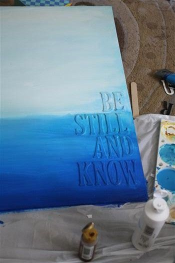 wooden letters glued onto canvas, then painted over.