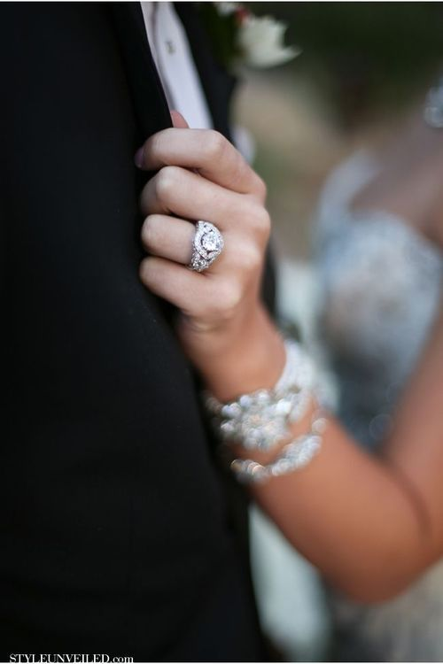 A great wedding photograph that looks more photojournalistic/candid and shows off the bride's rings.