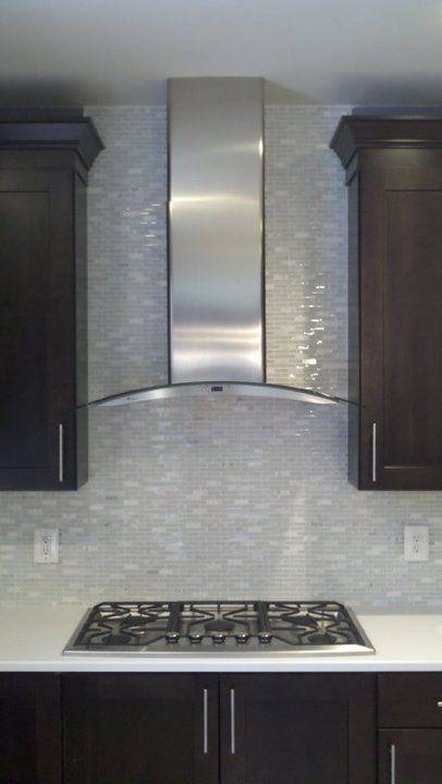 stainless range hood and glass tile backsplash kitchen interior design by skd studios skdstudios - Kitchen Ventilation Ideas