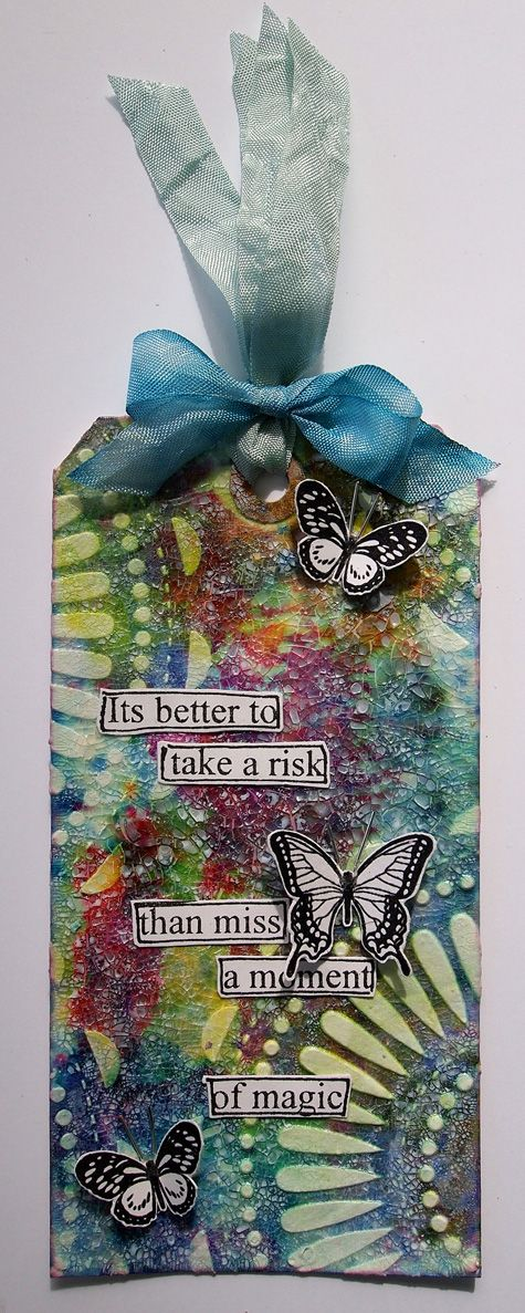 Stencil colourful glittery, blue, purple and orange with a yellow background. Butterflies and quote.