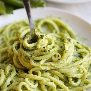 Zucchini noodles tossed together with a creamy avocado pesto that can be easily made in under 20 minutes for a perfectly healthy weeknight dinner!