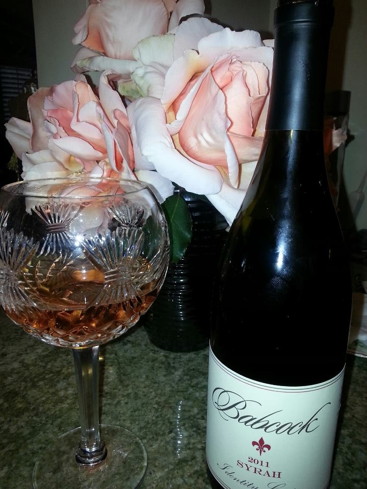 Babcock Identity Crisis Syrah with matching pink roses from mt friend's garden.
