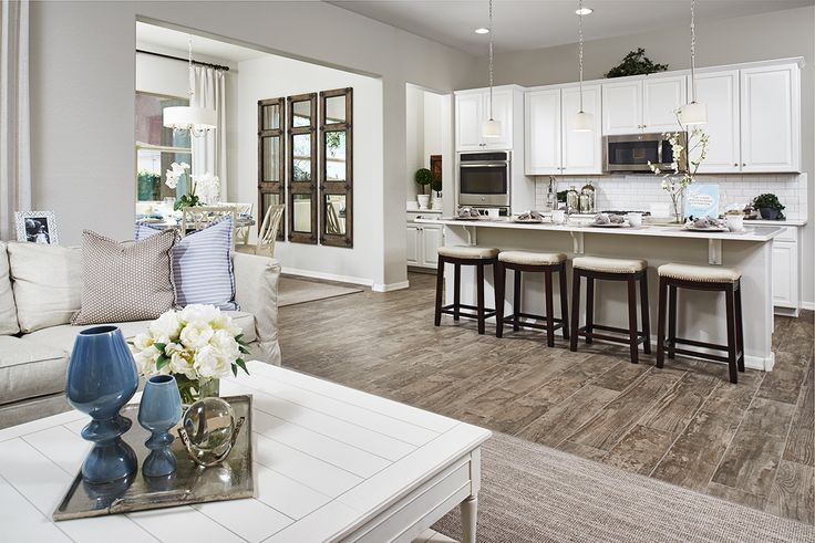 Love the contrast between the clean, white cabinets and countertops and the distressed-finish floor! | Allman model home | Mesa, Arizona | Richmond American Homes