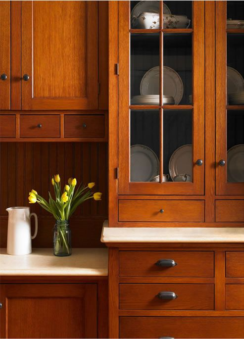 Shaker kitchen cabinets.  Look at the cute spice drawers under the cabinets, the white pitcher, glass front cabinet doors...
