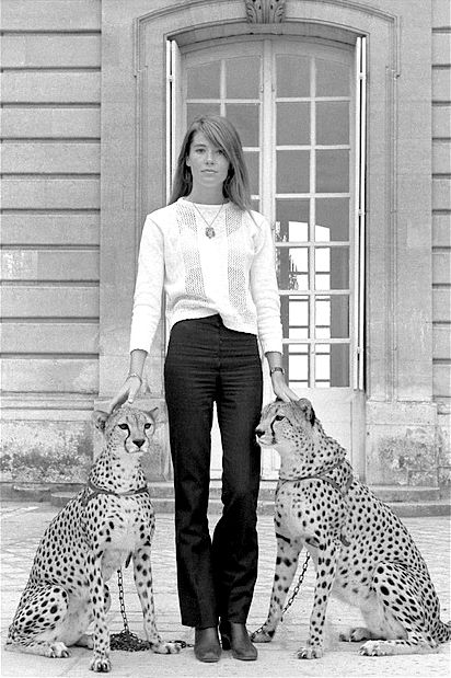 Françoise Hardy's slightly flared denim and white lacy top always look good. Cheetahs and dramatic setting are optional. Photographed by Hugues Vassal, 1969