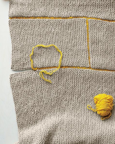KNIT BLANKET: If you can knit a scarf, you can make a blanket. (You don't even need to add or reduce stitches!) This coverlet is made from 12 individually knit rectangles of natural-colored wool, sewn together with a contrasting yarn, so the seams show.