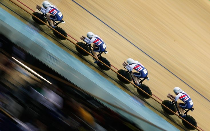 Ed Clancy, Steven Burke, Owain Doull and Andrew Tennant of Great Britain Cycling Team compete in the Men's Team Pursuit qualifying round during day 1 of the UCI Track Cycling World Championships held at National Velodrome in Paris, France.