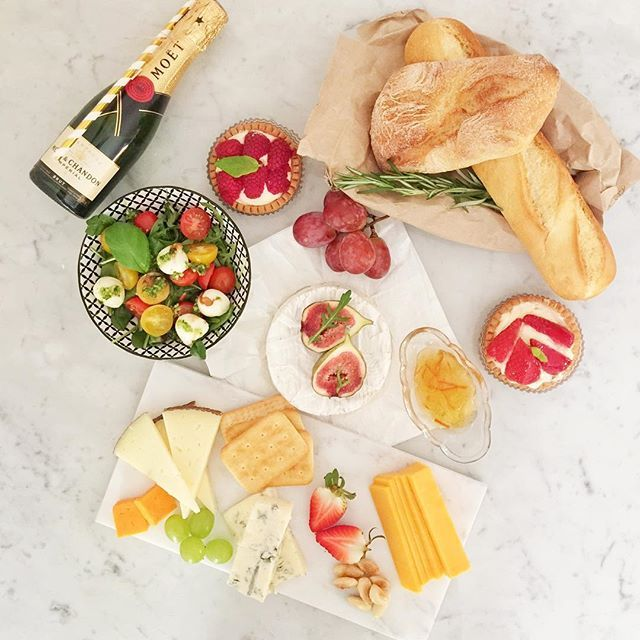 "We are in love with our ""Eat. Drink. Man. Woman."" #picnic set. •Delicious cheese • Homemade chutney • Fresh baguette • Caprese salad with pesto dressing • Dessert • Moët & Chandon  #moëtchandon #flatlays #flatlaystyle"