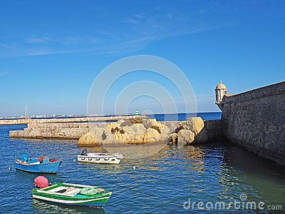 Boats are anchored in the habor near the Fortaleza de Ponta de la Bandeira, constructed in the late 1600's in Lagos, Portugal.