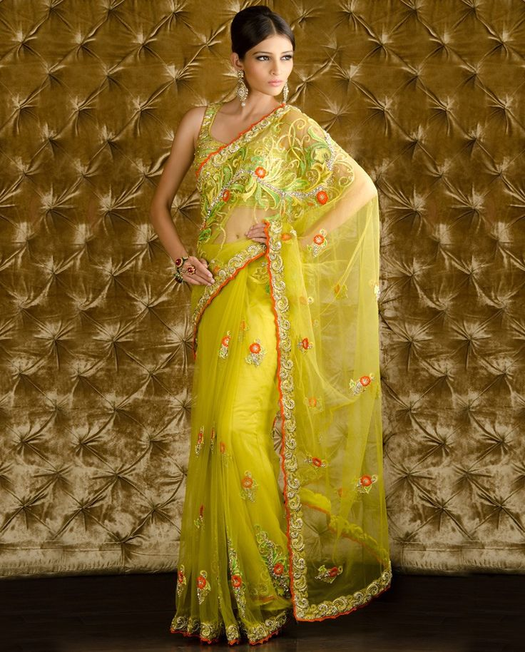 This saree is made of net fabric of lemon yellow color. This saree have high quality floral handwork embroidery which gives this saree a royal look. This saree accompanied with a matching blouse and p