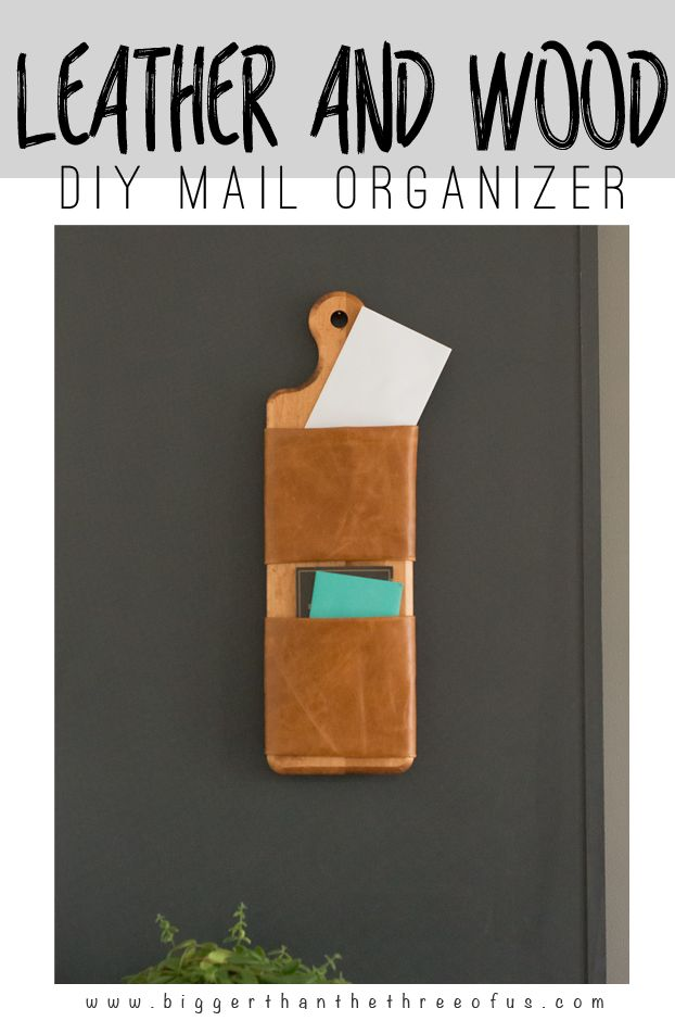 This DIY Leather and Wood Mail Organizer is so easy to make! Get the clutter off your cabinets with this simple leather and wood mail organizer!