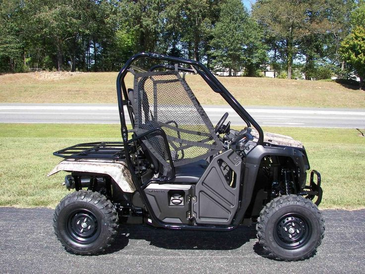 """New 2017 Honda Pioneerâ""""¢ 500 Camo ATVs For Sale in North Carolina. This is a new 2017 Honda Pioneer 500. This is a unique side by side that has a rear rack instead of a bed and has a way smaller footprint than the larger side by sides and a smaller price tag than most others. New for the 2017 model SXS 500 it offeres a fully automatic transmission with the paddle shifting manuel shifting mode as well.These utility vehicles should fit many styles of ridding from working to pleasure all at a…"""