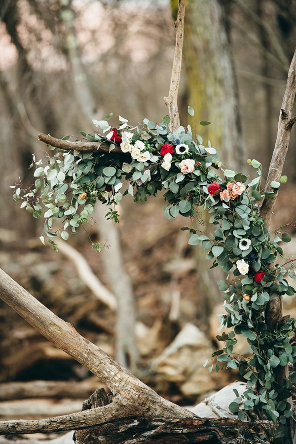 driftwood arch with eucalyptus and flowers, photo by Crystal Stokes http://ruffledblog.com/southern-simplicity-wedding-ideas #ceremony #ceremonies