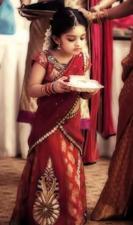 Ajith's daughter Anushkha in red Half Saree