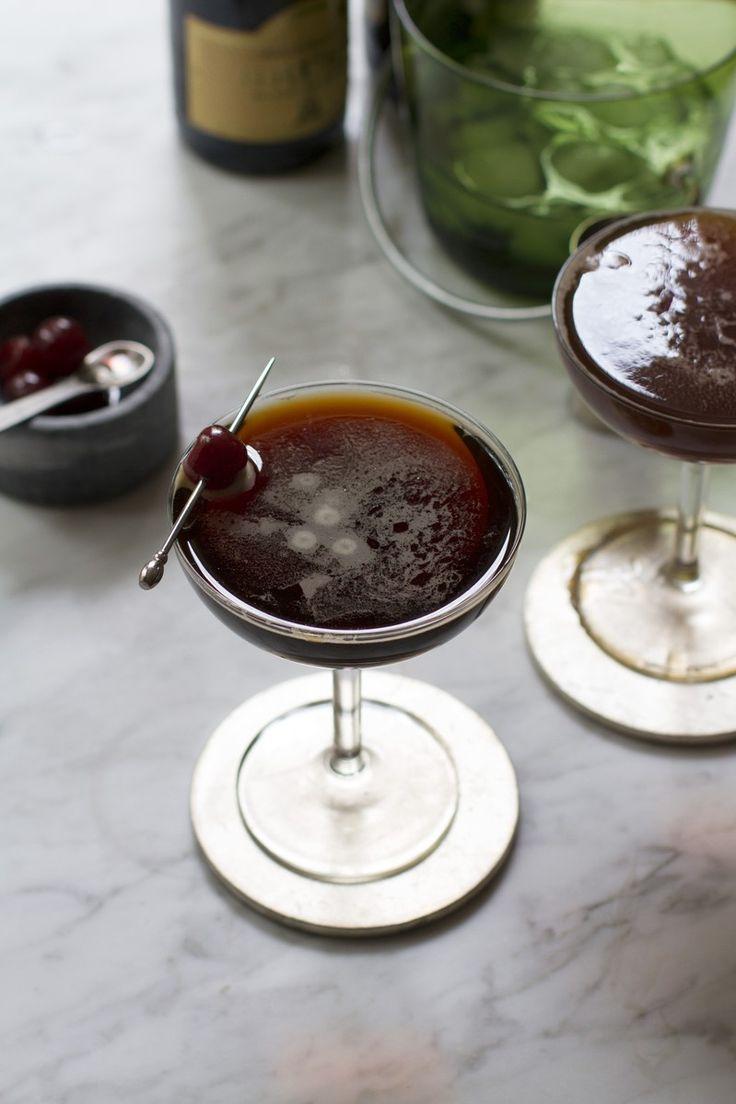 Black Velvet Cocktail - Guinness (Stout Beer), Brut Sparkling Wine, Creme de Mure or Creme de Cassis, Brandied Cherries.