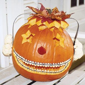 Teenager Pumpkin..Karla Grush-Erven of Auburn, WA, created a teenage pumpkin, complete with cauliflower headphones.    Read more: Cool Carved Pumpkins - Pictures of Cool Halloween Pumpkin Carvings - Good Housekeeping