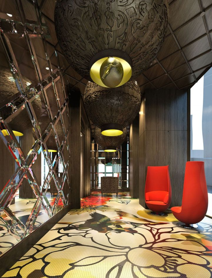 Exaggerated forms and colours that reference the busy Wan Chai streetscape outside are mixed with more delicate depictions of flowers in carpets and on walls. Cut mirror-glass, decorative wooden panels and glazed ceramics nod to traditional Chinese artistry while the overall effect remains firmly from this century.
