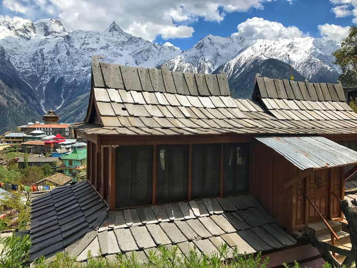 Typical kinnauri wooden house in Kalpa village with pagoda slater roof