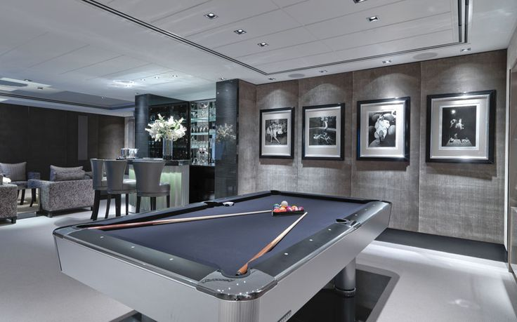 This atmospheric basement conversion in St John's Wood uses a grey colour scheme to give a modern touch to an underground snooker room.