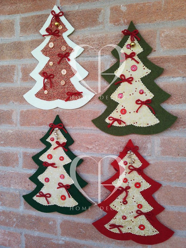Fir trees adorned with decorative felt Christmas American fabric finished with hand stitching to which they are applied buttons, bows and wool rattles