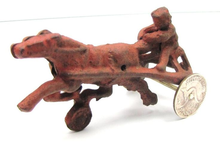 COLLECTIBLE: ANTIQUE Cast Iron Trotting Race Horse 1941 Copper Penny Wheels