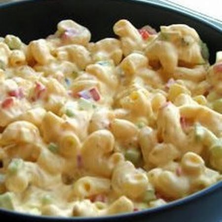 Amish Macaroni Salad - A colorful and flavorful macaroni salad made with hard cooked eggs, bell pepper and celery in a creamy dressing. Best macaroni salad I have ever had