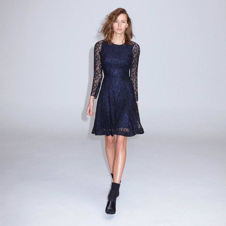 FWSS Liverpool is a delicate lace dress with long sleeves and a flared skirt. Centre back zipper.