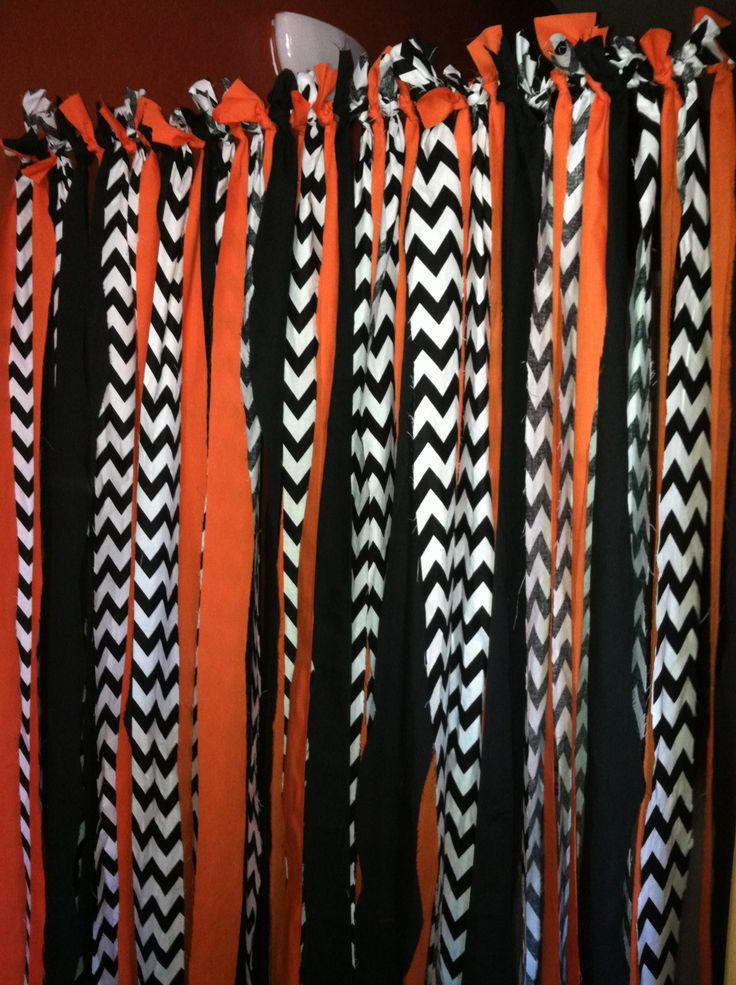 Halloween Backdrop for Halloween Party  Used 2 Yards of each fabric, cut up in 2-3 inch widths.