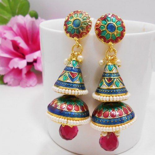 This meenakari shanku tokri jhumar is based on a copper metal dome crowned by a copper metal cone. Both are polished in high gold and covered up in meenakari / enameling in multiple colors and edged with moti bandhai. The dome is filled with cutting matching color drop and the top part of the earring is based on circular pendant which is also enameled in similar combination as that of the dome and cone.