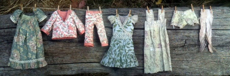 "Here are my little wee paper dresses, measuring 7"" high at most. Handmade by me!"