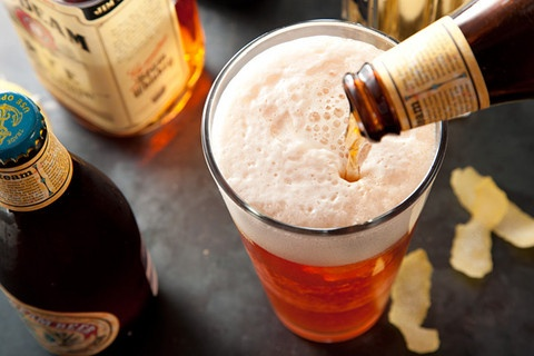 Steamroller (so delish)  1 ounce St-Germain elderflower liqueur  1 ounce freshly squeezed lemon juice  1 ounce rye whiskey  1/2 ounce Heering Cherry Liqueur  Ice  1 lemon twist  1 (12-ounce) bottle steam beer, such as Anchor Steam, chilled