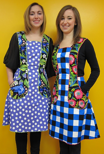 Love these aprons!--looks like this blog has moved and this link needs a bit of research. Very nice coverage on these aprons. On July 9, 2009 this apron is modeled. Vintage pattern.