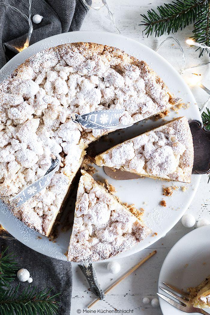 Ein Winter Wunderland Apfelkuchen, mit Spekulatius, Haselnusskernen und Marzipan Streuseln. Perfekt für die kalte Jahreszeit.