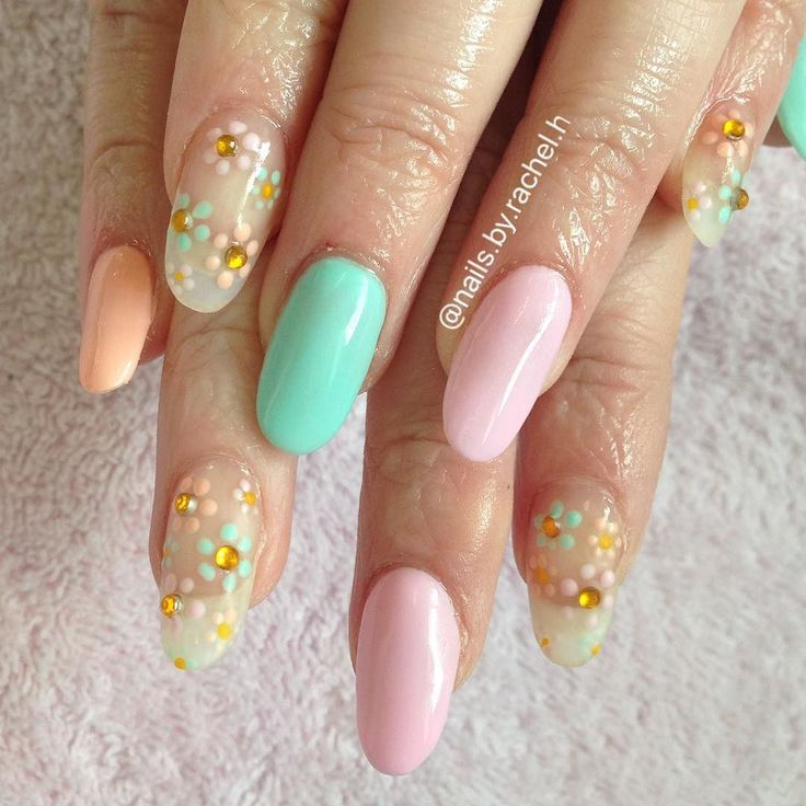 Love these Spring beauties  Poor Julia battled through the pain of her carpel tunnel syndrome for a nice new set off nails felt like a right meanie though  Clear acrylic extensions with gel polish design I used @the_gelbottle_inc 062 (peach)  102 (pink) and 120(mint) and gems from @charliesnailart  #nails #nailart #thegelbottleinc #acrylicnails #rotherham #rotherhamnails by nails.by.rachel.h