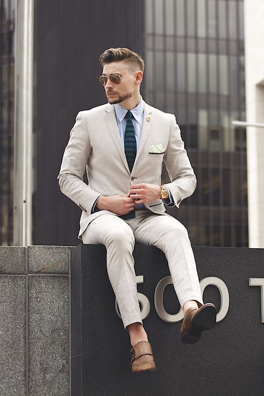 Tap into refined, elegant style with a beige suit and a light blue dress shirt. Brown leather double monks will add a new dimension to an otherwise classic look.   Shop this look on Lookastic: https://lookastic.com/men/looks/suit-dress-shirt-double-monks/17453   — Light Blue Dress Shirt  — Dark Green Horizontal Striped Tie  — Beige Suit  — Brown Leather Double Monks  — Brown Sunglasses