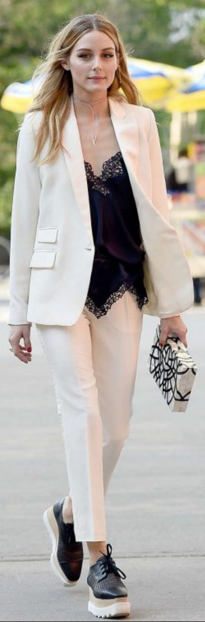 Who made Olivia Palermo's platform black shoes, necklace, gold jewelry, and clutch handbag?