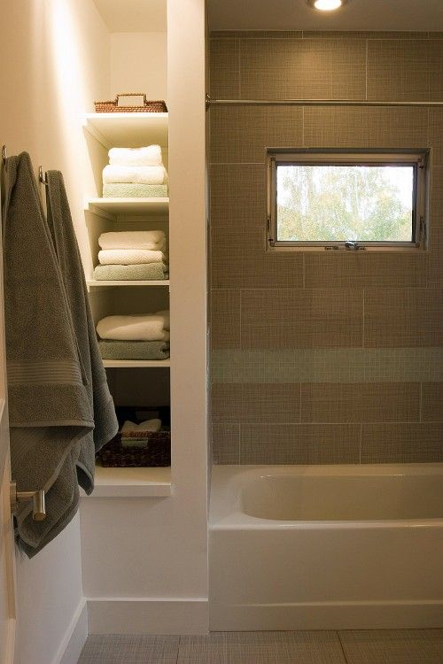 linen shelves next to tub/shower. If we ever get around to installing a second bathroom, I'm doing this!