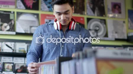 Young Man Browses of vintage records — Stock Video © reeldealhd #125800612