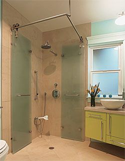 Its centerpiece is an accordion-style shower stall, with frosted-glass doors that fold back against the wall to make the modest 6-ft. by 7-ft. space seem as generous as possible.