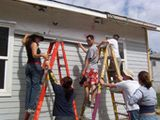 Habitat for Humanity - Volunteer, Sponsor or become a Home Owner at Habitat: Habitat volunteers from UC Davis put up siding.