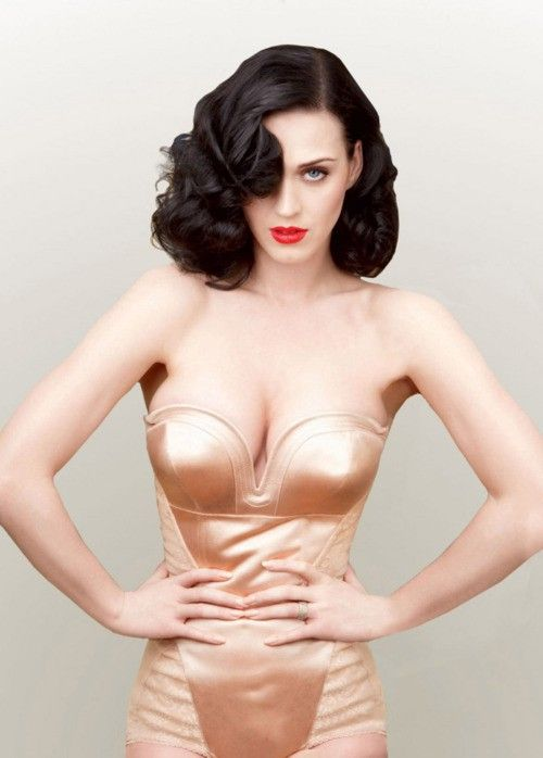 Katy Perry radiates Old Hollywood Glam in a vintage corset, romantic curls and ruby red lips and exudes total confidence.